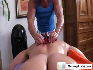Studly masseuse gives gay young man Dylan a deep massage with toys