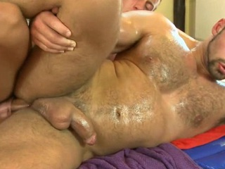 Rubbing that firm smooth iled body of his