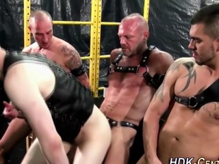 elated dudes are wearing some leather and being dominant