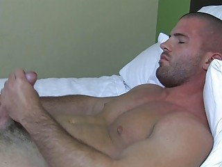 Sexy muscled gay stud plays around his hard bazooka round bed