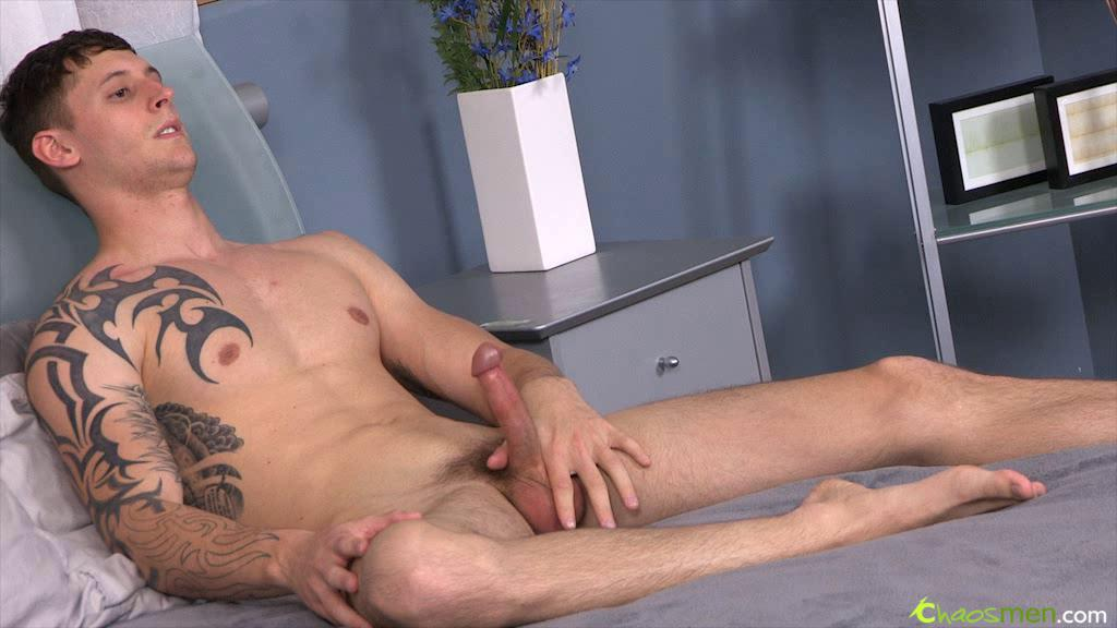 Tattooed guy is relaxing by stroking his cock