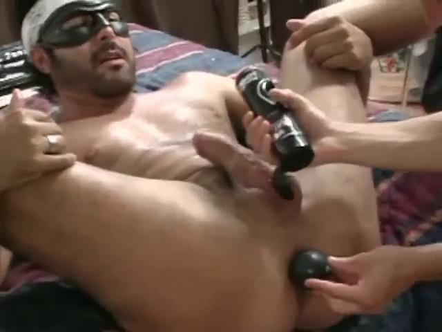 Covered hunky gay gets his mean pain in the neck stretched with a large dildo