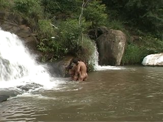 These nudist well-pleased twinks like to bath under waterfall