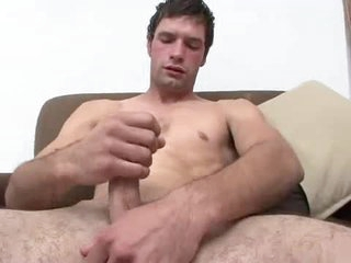 Sexy young guy masturbates together with cums