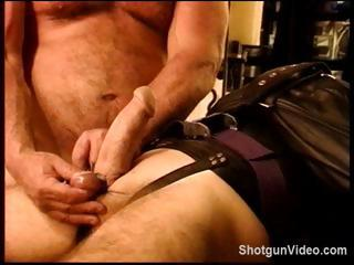 Slave gets some hideous torture from his specialist on his cock and balls