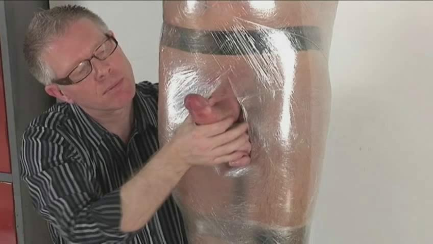 Gay fella with hard dick gets tied and wrapped of a piece with a mummy