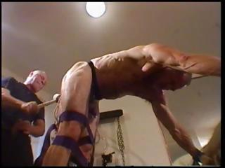 Coxcomb is tied up and bent over close to his old hand abusing his ass