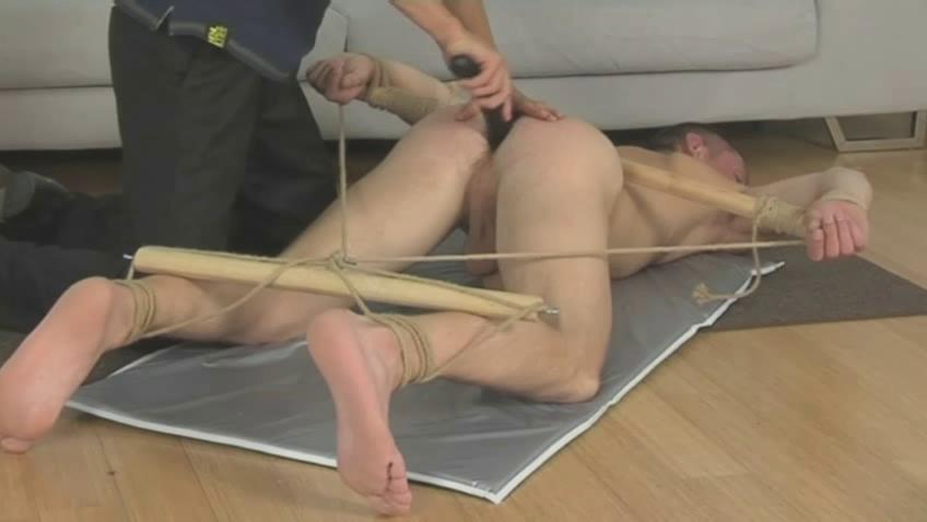 Tied blissful fella gets whiped with a horse whip on the floor