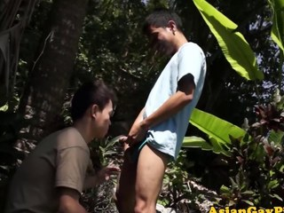 Piss drenched Asian twink sucking at bottom a cock